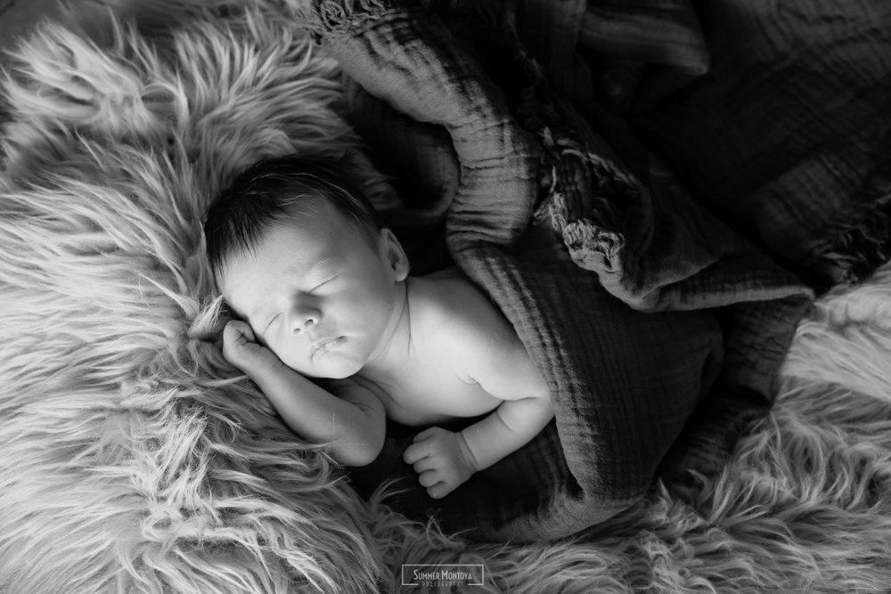 Newborn baby boy, in home photo shoot.