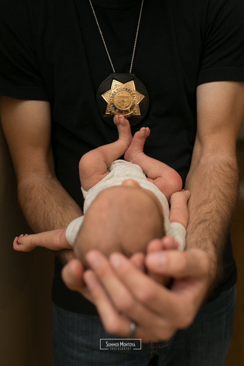 newborn-girl-with-police-officer-dad