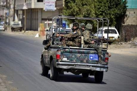 Soldiers patrol a street in Sanaa. Photo by Yahya Arhab/EPA.