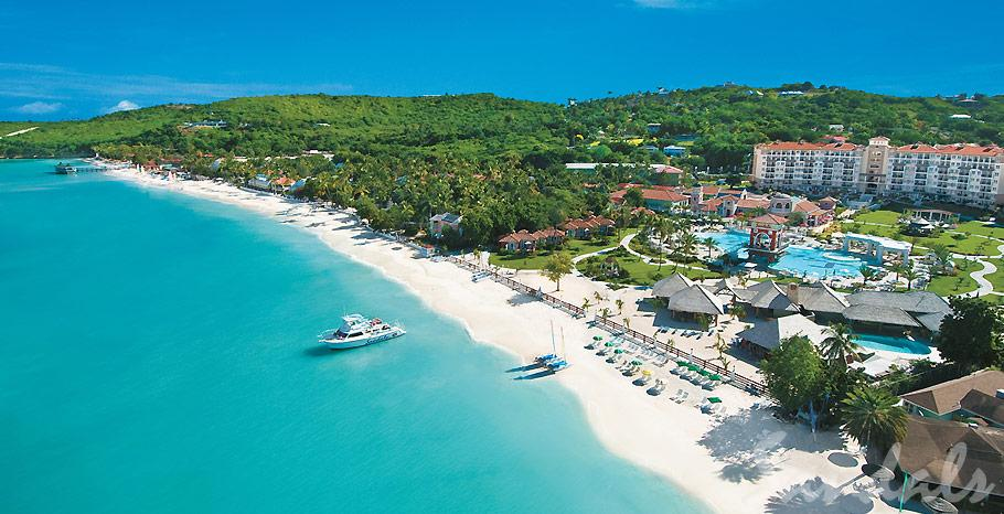 Gracing the island's northwest coast, and cradled alongside the Caribbean Sea, Sandals  Grande Antigua  boasts and enviable presence on Antigua's most famous beach. Sophisticated travelers and celebrities alike, are drawn to the shores of Dickenson Bay, the most protected beach in all Antigua, renowned for its forever-calm waters. Edged by a mile-long reef, the crystal-clear waters in every shade of blue are always placid, perfect for snorkeling, diving ,paddle boarding and lazy swims together. Come relax on silky soft, pure white sands and let the warmth of the Caribbean fill your senses