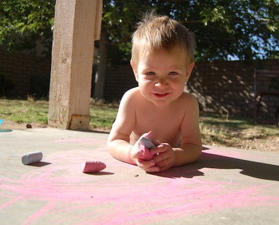 little boy holding chalk