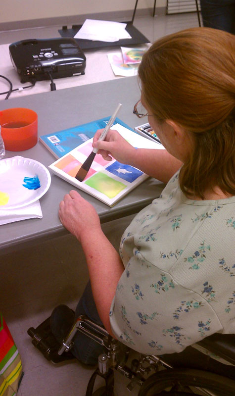 student painting in watercolor class