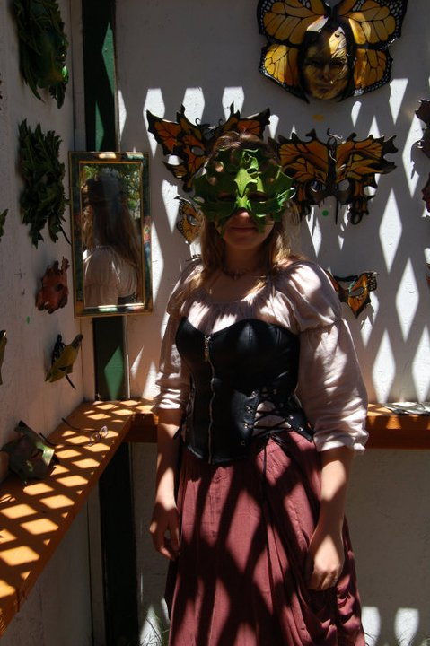 renaissance faire girl wearing corset and mask