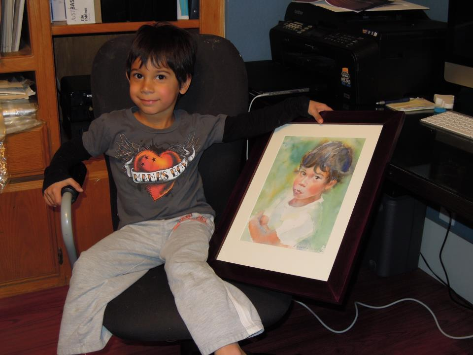 child with his portrait painting