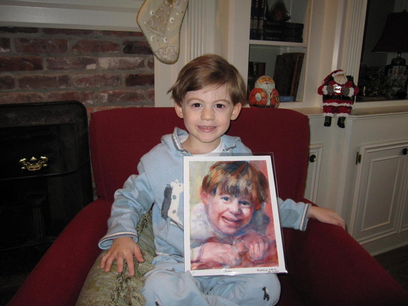 boy holding a painting of himself