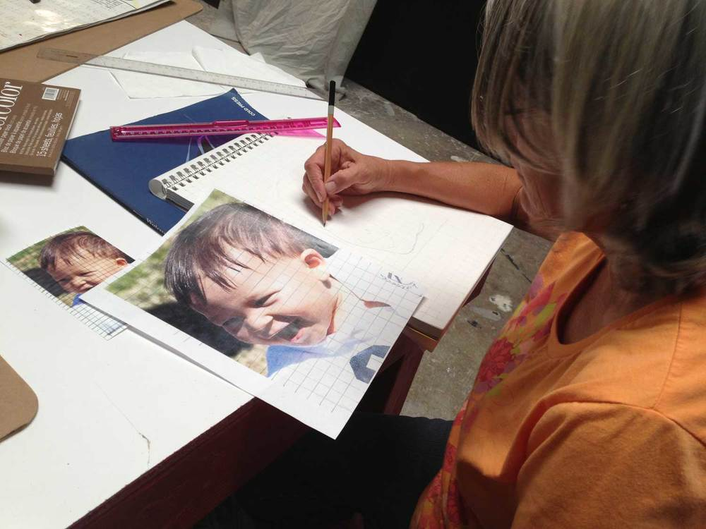 Vicki making a grid drawing of her grandson