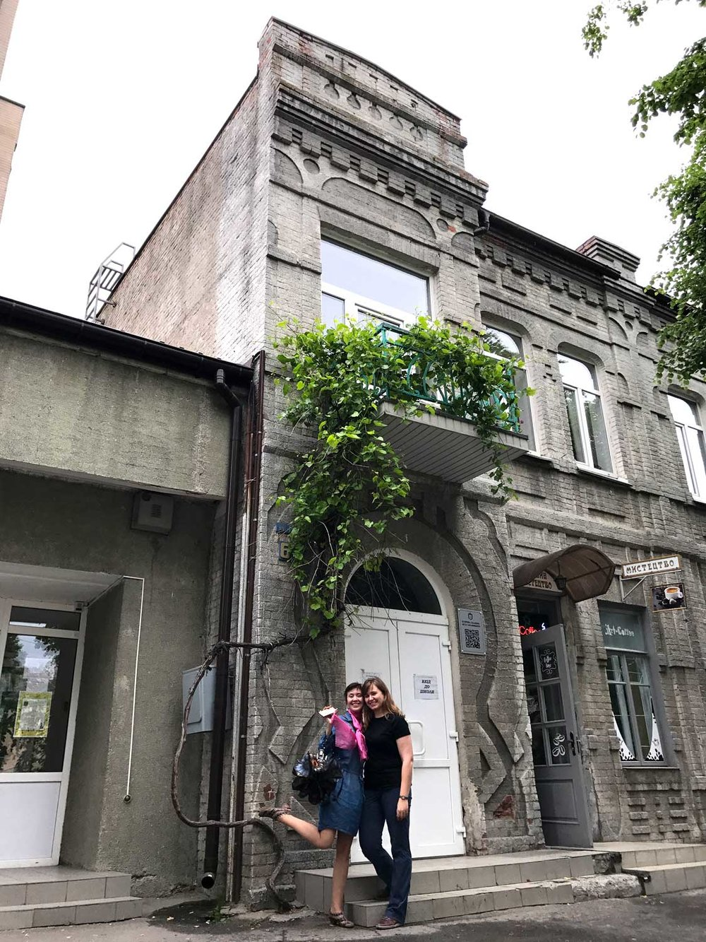 Where it all began: me with my friend Larisa, aka Lara, next to the building of our art school.