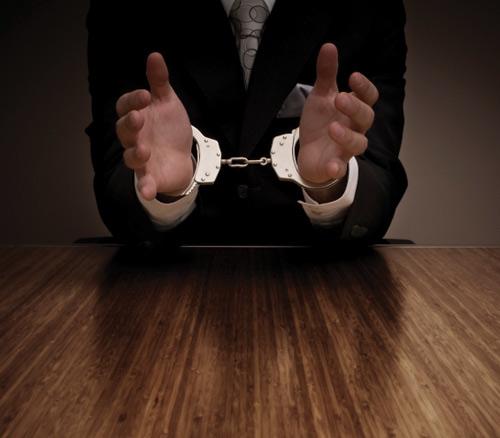 businessman-in-handcuffs.jpg