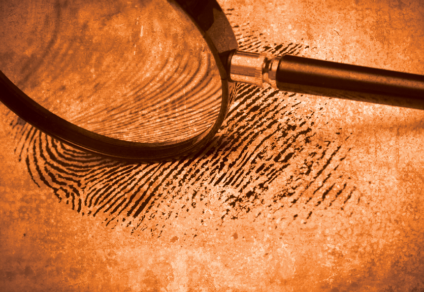 magnifying glass on fingerprint orange.jpg