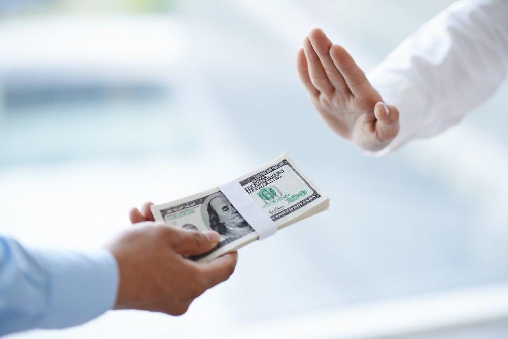 hand refusing money.jpg