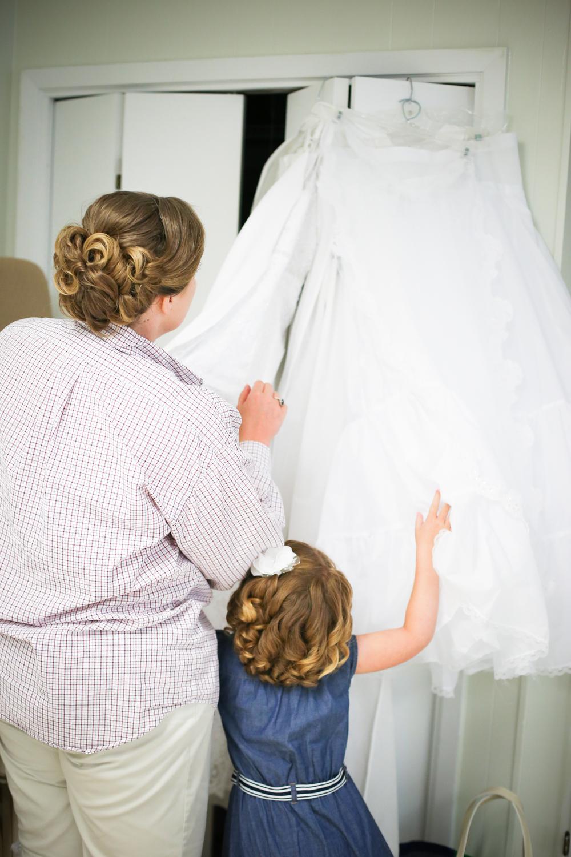 Amanda & her new daughter looking on in awe at Amanda's beautiful gown.