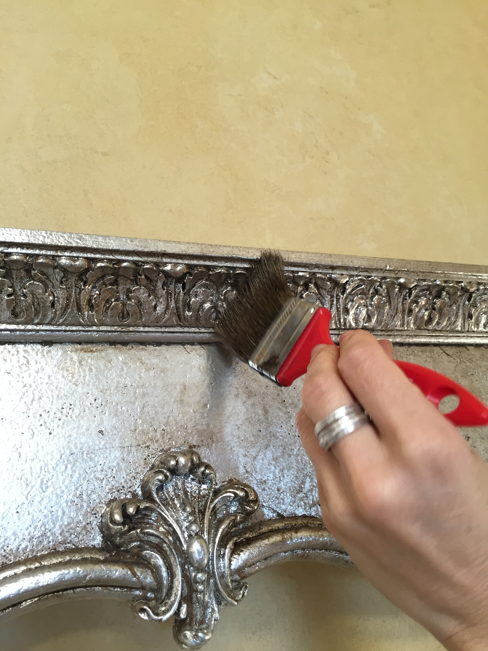 Silver leafing of a LARGE mirror which will be hanging over a fireplace in the family rooom.