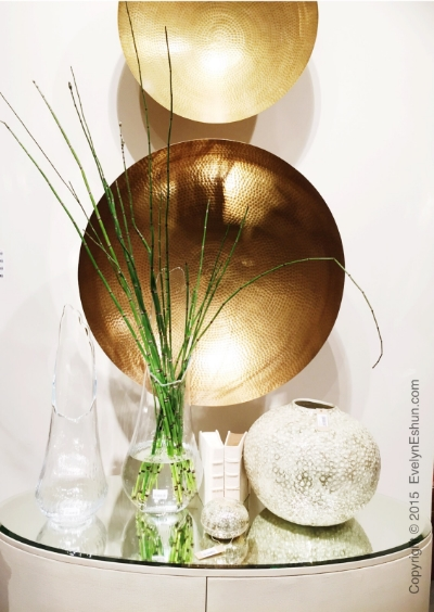Simple display which I saw at the Las Vegas Market this past January...gold bowls on the wall...