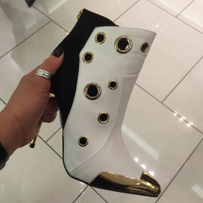 I even saw a very cool pair of booties with white and gold at the Venetian Hotel...and a touch of black..too bad they didn't have my size.!!
