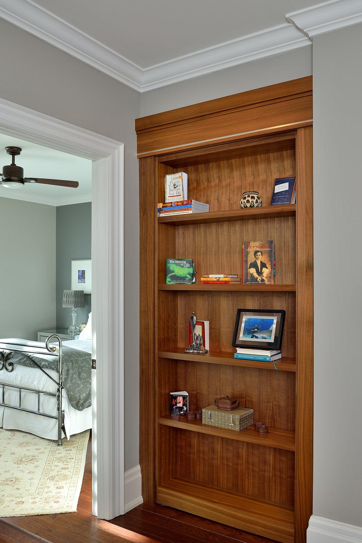 A secret door leading to a home office over the three door garage.