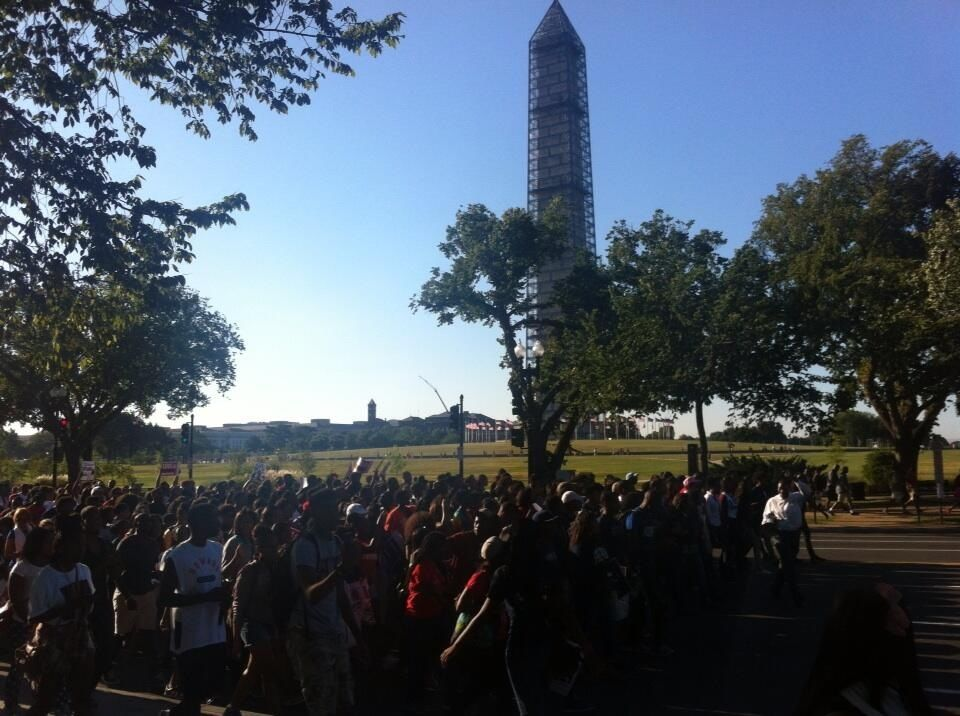 Howard U passing Washington Monument. Wonder what old George would think?