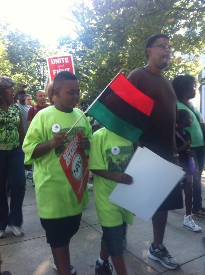 Young brothers heading  to the reflecting pool. The Red. The Black. And The Green. Conscious and on point.