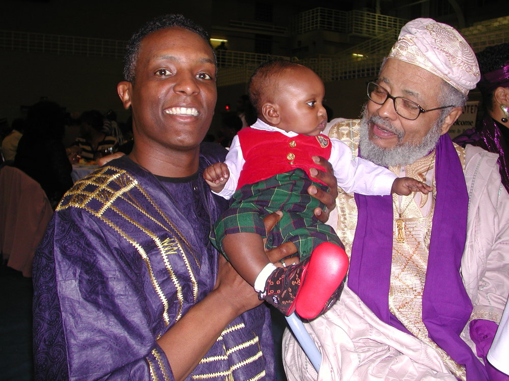 - Ellington Fuller, 5 months, with Jacob Carruthers and the author, 21st Association for the Study of Classical African Civilizations Conference, Tennessee State University, March 2003.