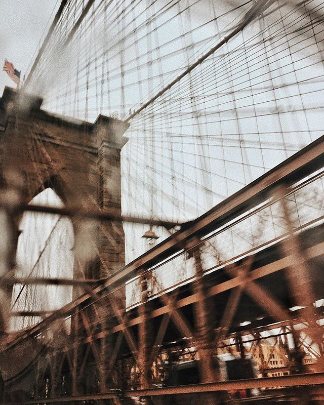 "A slightly blurry Brooklyn Bridge through the rainy windows of an uber with @kaitiebryant • Lots of good (& much needed) convos about things we've been thinking about lately and updates on where we're finding ourselves these days. On the plane ride back, I heard this quote in a @_big_magic_ episode with @glennondoyle... ""The definition of an artist is someone who walks around saying 'don't erase me.'"" • I'm so grateful for friends who remind me of who I am and encourage me to put myself out into the world, especially by just doing that in their own ways - as makers, mothers, writers, designers & friends. • More from that episode (209): ""The other rule for myself is to put myself out there, but NOT to babysit it. I can't follow it around making sure everyone likes it. That's not my job. People don't quit because they're not artists, they quit because they're not lawyers. They don't quit because they didn't like making the thing, they quit because they can't handle defending the thing...which was never their job.  Don't consider your art your baby, because if you do you'll have to follow it around and babysit it. Release it."" • Here's to increasing attempts at sharing more of myself and babysitting less, even if just internally."