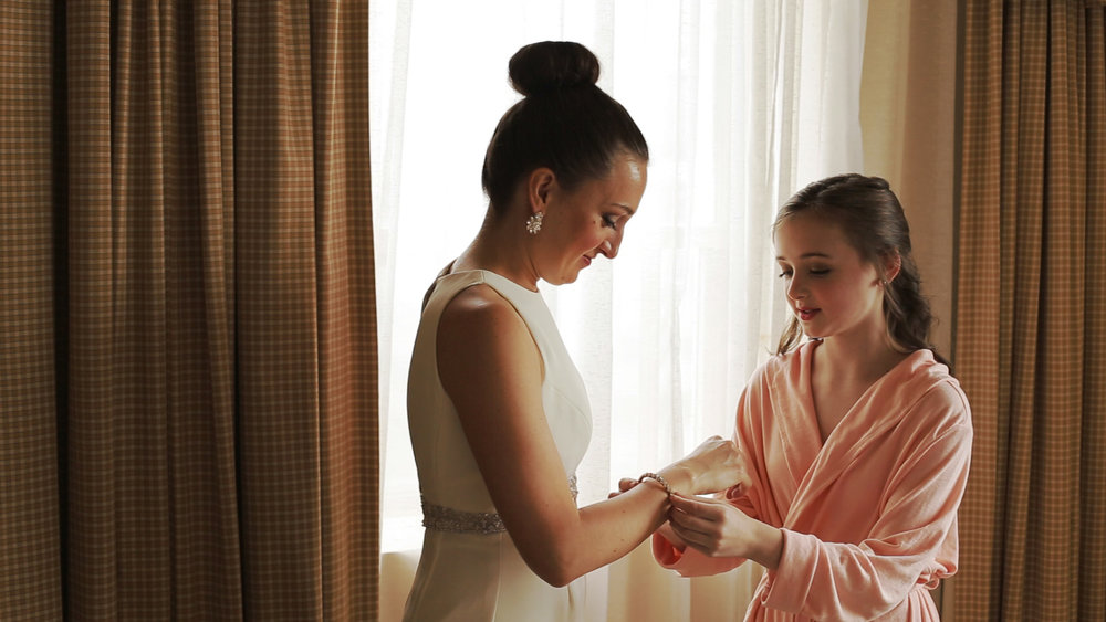 Bride and her niece getting ready before the wedding