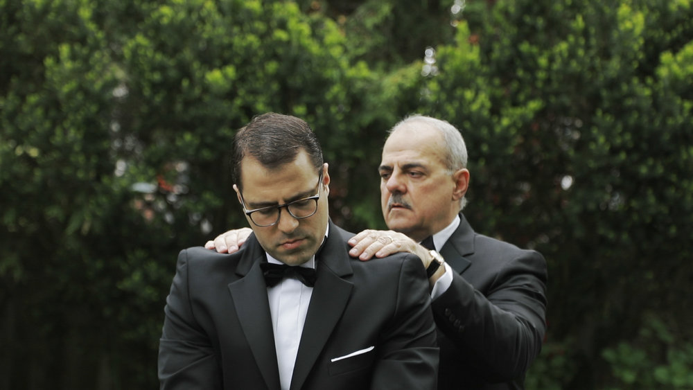 Groom and his father before the wedding
