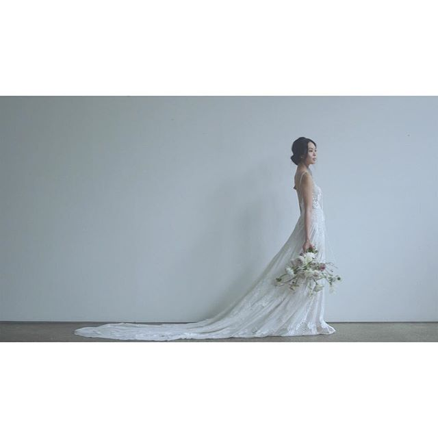 engaging with space and light. . . . . #bride #bridalinspo #beautiful #weddingdress #bridalgown #vignette #editorial #editorialshoot #poetry #videoseries #story #andifyoulistentothelight #bare #space #minimalism #close #sparse #portrait #white #ornate #bridalflowers #bouquet #whiteflowers #weddingbouquet