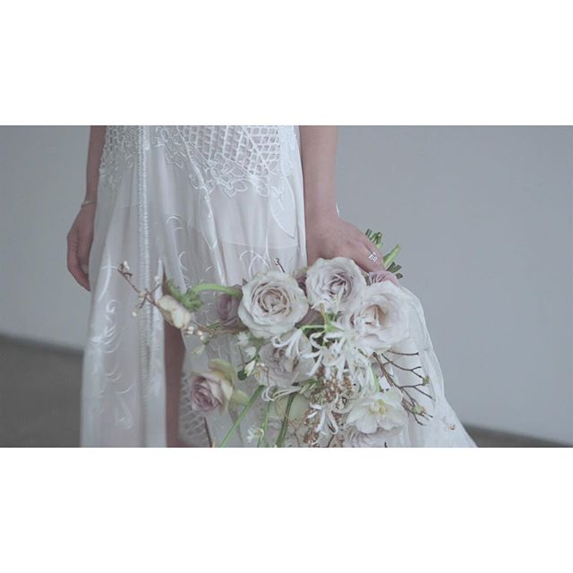 there's a special poetry in passing details. . . . . #bride #bridalinspo #beautiful #weddingdress#bridalgown #vignette #editorial #editorialshoot#poetry #videoseries #story #andifyoulistentothelight#bare #space #minimalism #close #sparse #portrait#white #ornate #bridalflowers #bouquet#whiteflowers #weddingbouquet