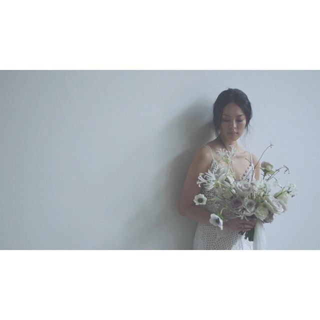 light and shadow. . . . . #bride #bridalinspo #beautiful #weddingdress #bridalgown #vignette #editorial #editorialshoot #poetry #videoseries #story #andifyoulistentothelight #bare #space #minimalism #close #sparse #portrait #white #ornate #bridalflowers #bouquet #whiteflowers #weddingbouquet #light #shadow