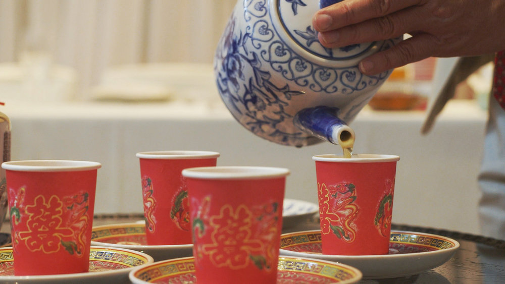 Pouring tea at traditional Chinese tea ceremony