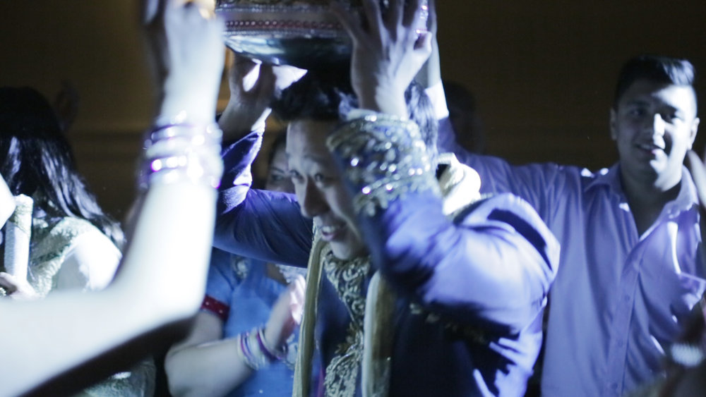 groom celebrating at Indian wedding