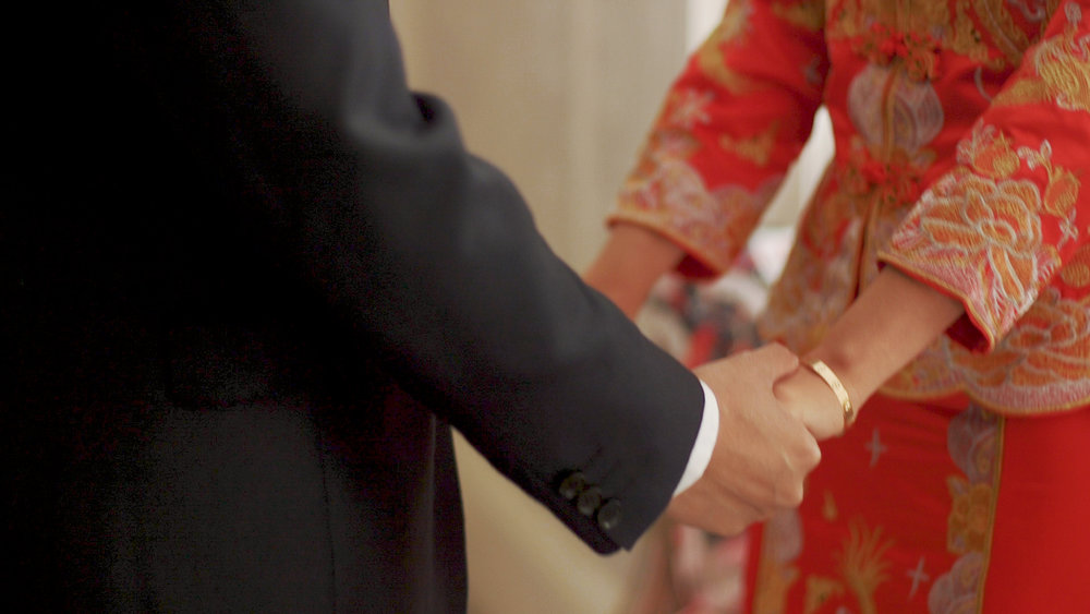 Family holding hands at Toronto wedding