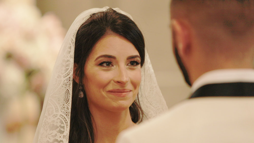 Bride smiling at modern wedding ceremony