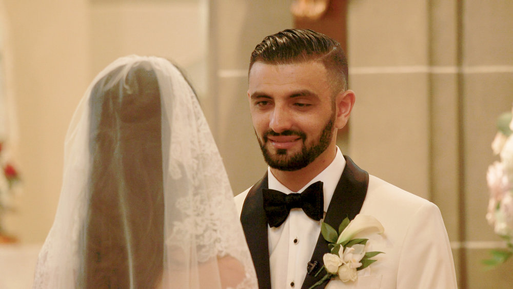 Groom smiling at modern wedding ceremony