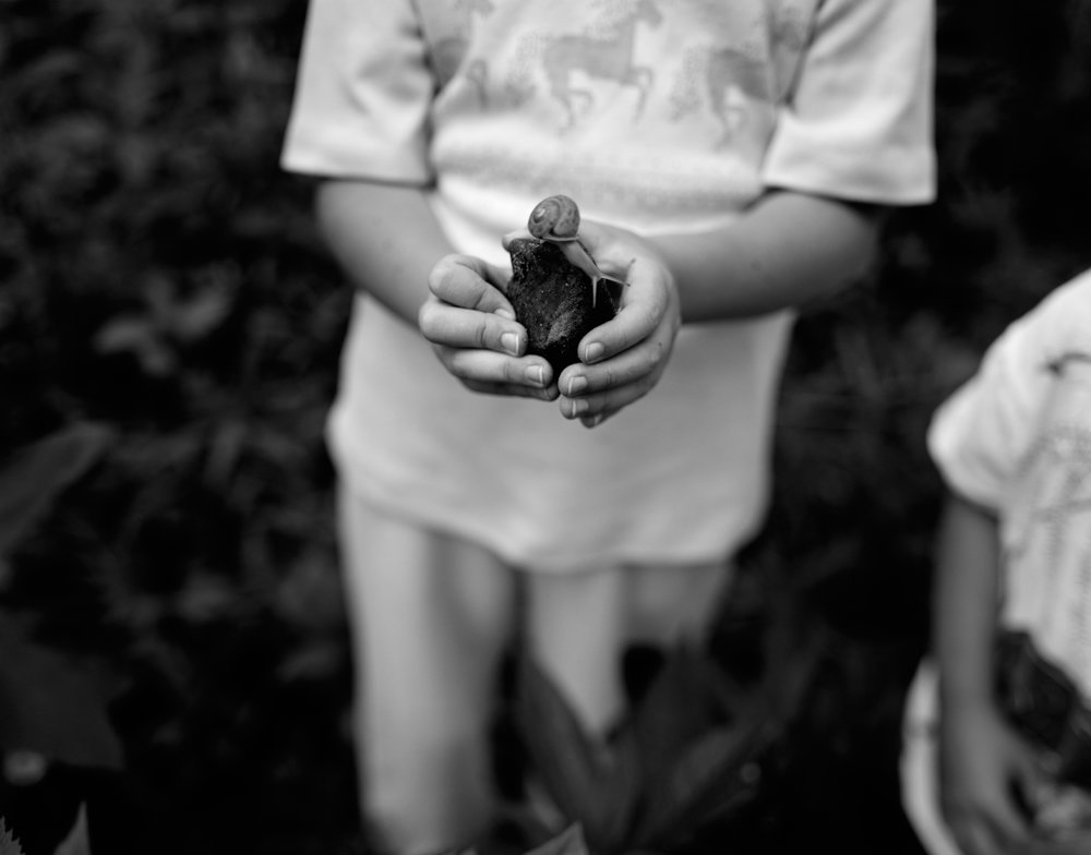 Katie showing me a snail she found down by the stream, Novelty, 1990