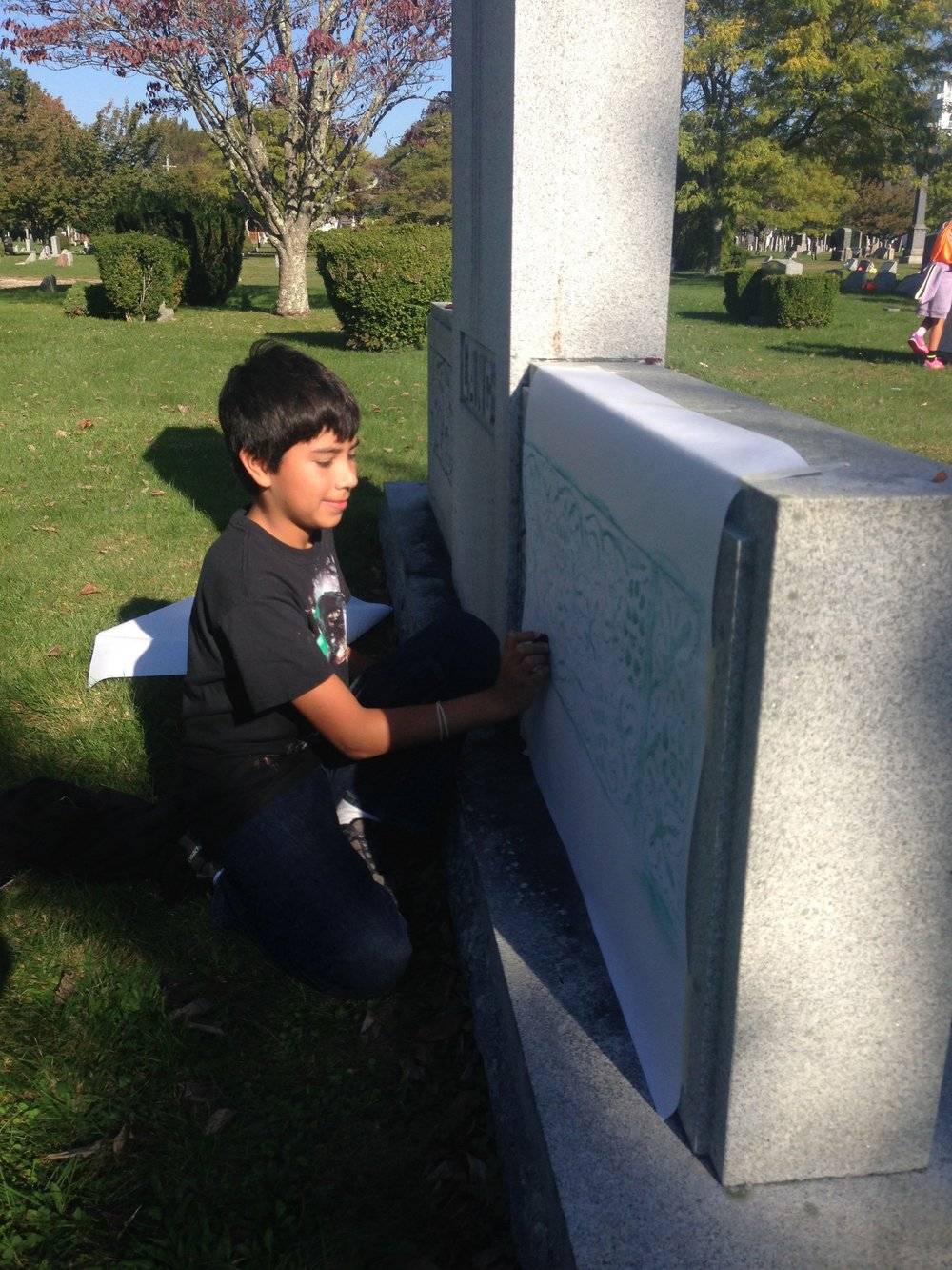 Joe chose to do a rubbing of a floral portion of this large monument