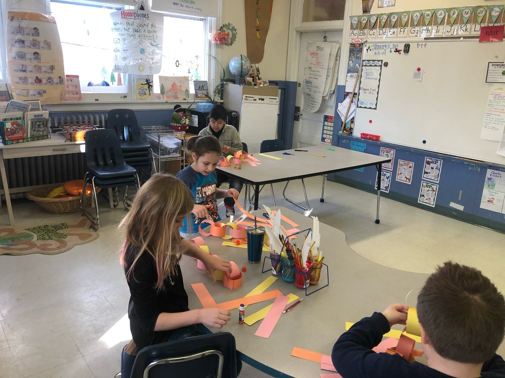 First, we made pink, yellow, and orange paper chains.