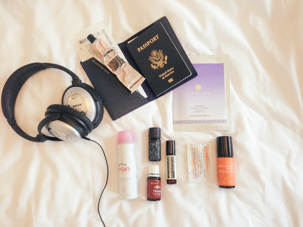 waiting for saturday : in-flight essentials bose headphones, theives oil, smythson passport case