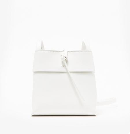 Basically my dream bag: Teeny, tiny crossbody with zero hardware. Keys, phone, wallet, done. -Olivia