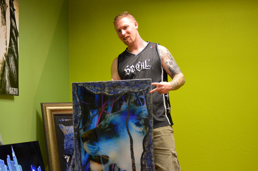 Frankie Darkstar with one of his art pieces