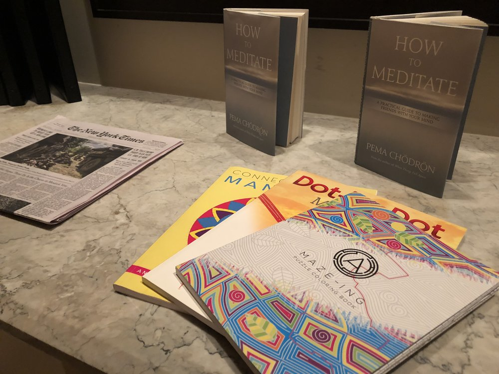 Books on meditating and coloring books in the spa at the MO.