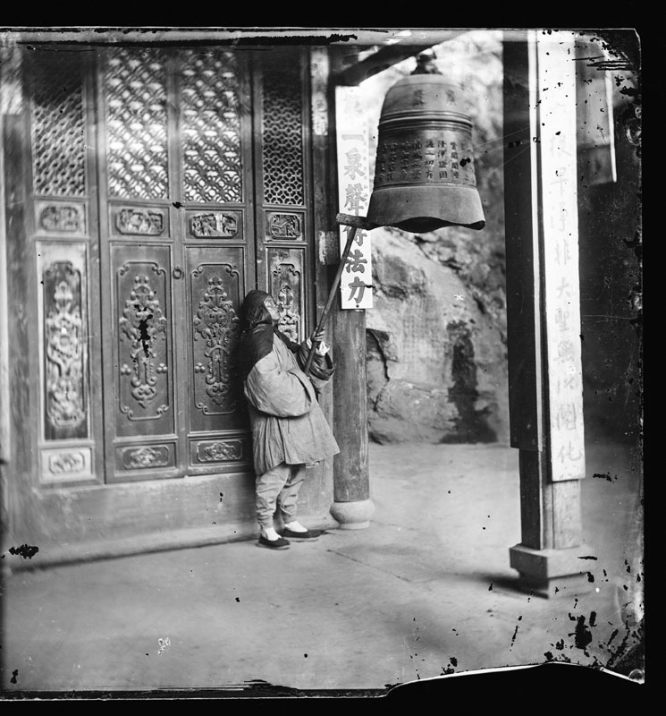 A Monk Ringing the Bell at Yeun-fu Monastery