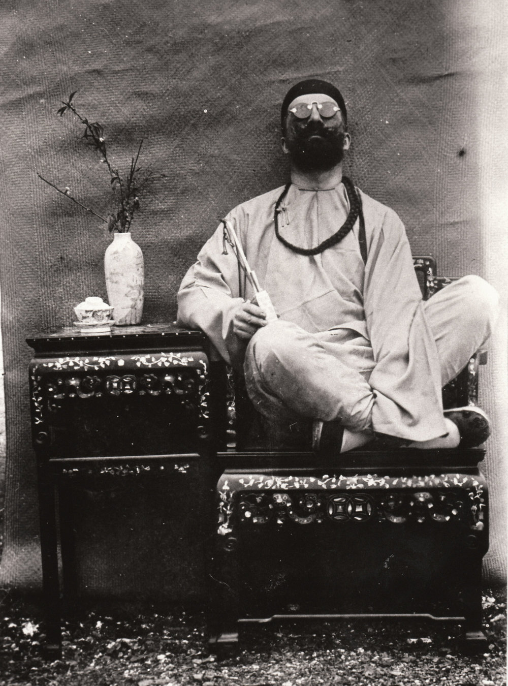 Auguste François disguised as Chinese smoker with a fake braid, Guangxi, 1896
