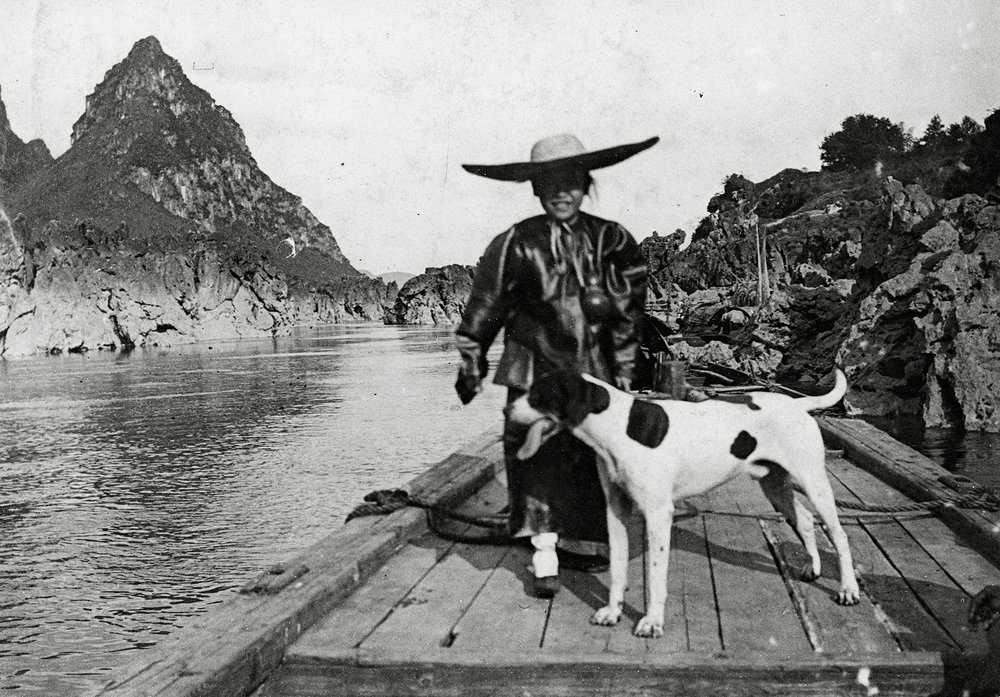 Auguste François, Navigating on the Xijiang, young boy adopted by Auguste François and his dog Haro, Guangxi, 1899
