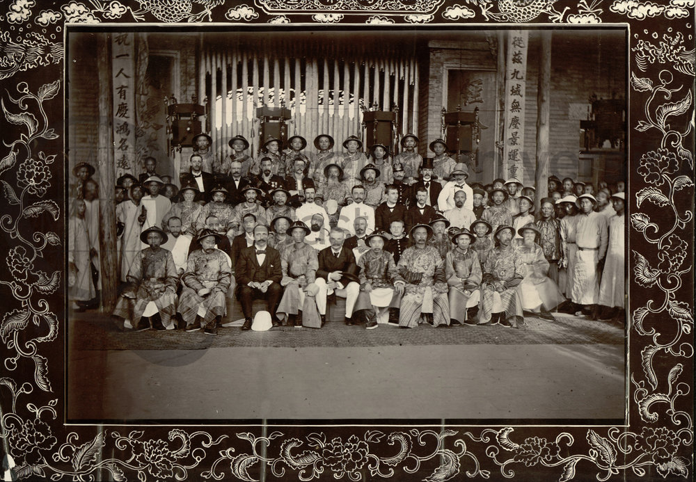 QUB Special Collections and Archives Photograph taken in Wuchang of a large group of British and Chinese men which includes the Viceroy and Governor, 30 July 1902. The photograph is annotated, 'Viceroy and Governor second row [from the back in the middle of the row sitting next to each other] sitting with Consular Body on right and left'. Reference: MS 15.6.3.023
