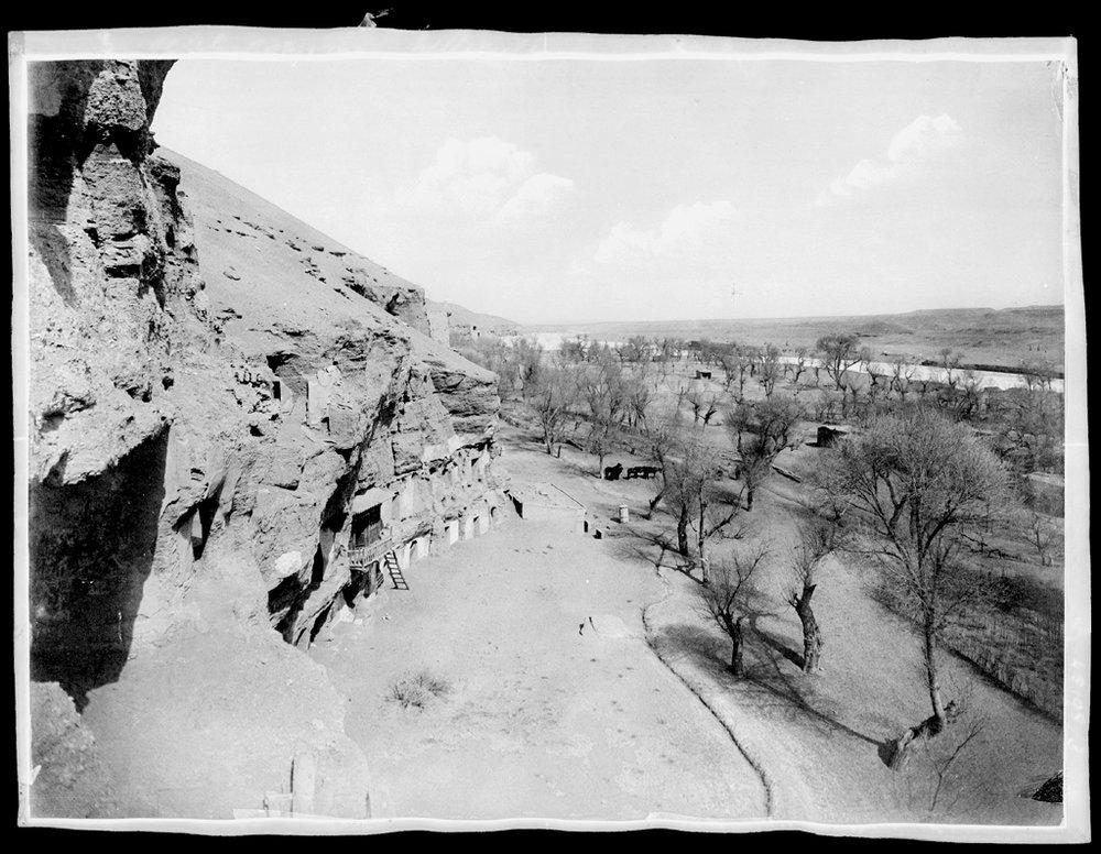 [Chine. Province du Gansu], vue de Touen-Houang [Dunhuang, vue de la vallée, prise de la grotte 16] [China. Province of Gansu, view of Dunhuang, view of the valley taken from the grotto 16]. 1908. Digital photograph after a gelatin silver negative on celluloid roll film, 18 x 24 cm (AP8204; Old number 3). From Paul Pelliot's mission. © Musée Guimet, Paris (dist. RMN-GP) / image MNAAG