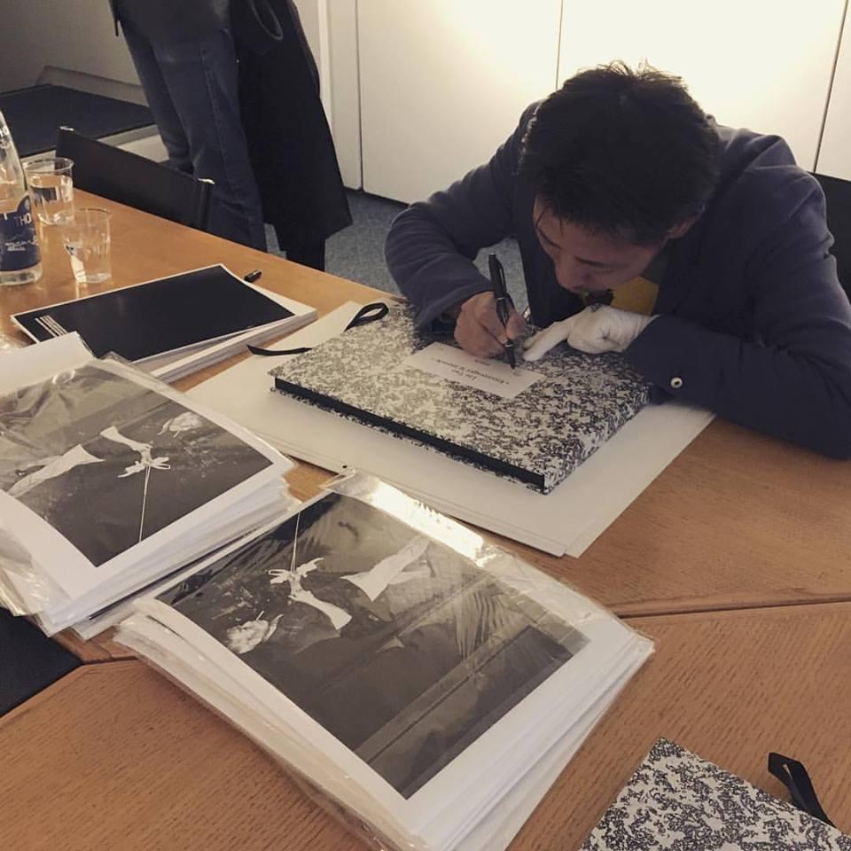 Liu Tao signing his limited edition portfolio / Courtesy of Galerie Folia