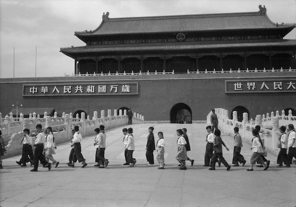 Young Pioneers and soldiers marching in front of Tien An Men, Peking (Beijing) 1956 | Courtesy of Tom Hutchins Images Ltd., New Zealand