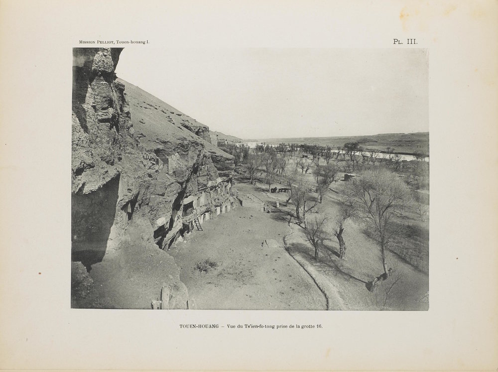 """PL. III: TOUEN-HOUANG—Vue du Ts'ien-fo-tong prise de la grotte 16."" From a silver gelatin negative on celluloid roll film taken in 1908, 18 × 24 cm (AP8204). Source: Pelliot, Paul. ""Les grottes de Touenhouang peintures et sculptures bouddhiques des époques des Wei, des T'ang et des Song,"" in NII ""Digital Silk Road""/Toyo Bunko, doi: 10.20676/00000186, accessed August 11, 2018,  http://dsr.nii.ac.jp/toyobunko/VIII-5-B6-3/V-1/"