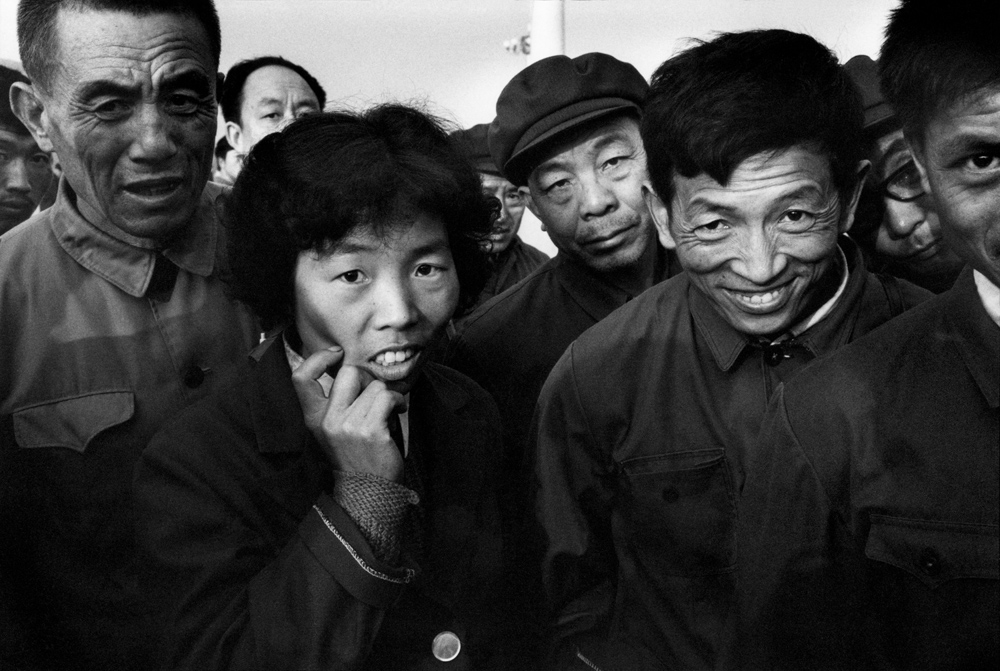 "Patrick Zachmann, 'A group of Chinese watching ""the Long Nose"", a term which refers to all westerners, including the photographer', Beijing, China, 1982. © Patrick Zachmann/Magnum Photos"
