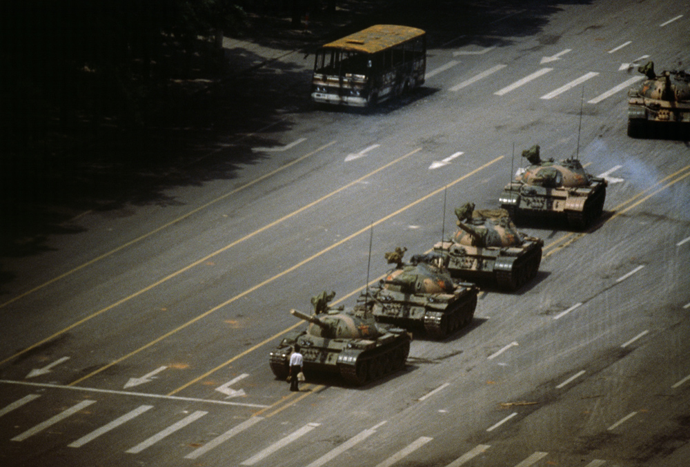 "Stuart Franklin, 'Tien An Men Square. ""The Tank Man"" stopping the column of T59 tanks', Beijing, China, 4th June 1989. © Stuart Franklin/Magnum Photos"